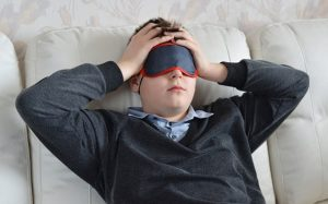 a boy with phonophobia